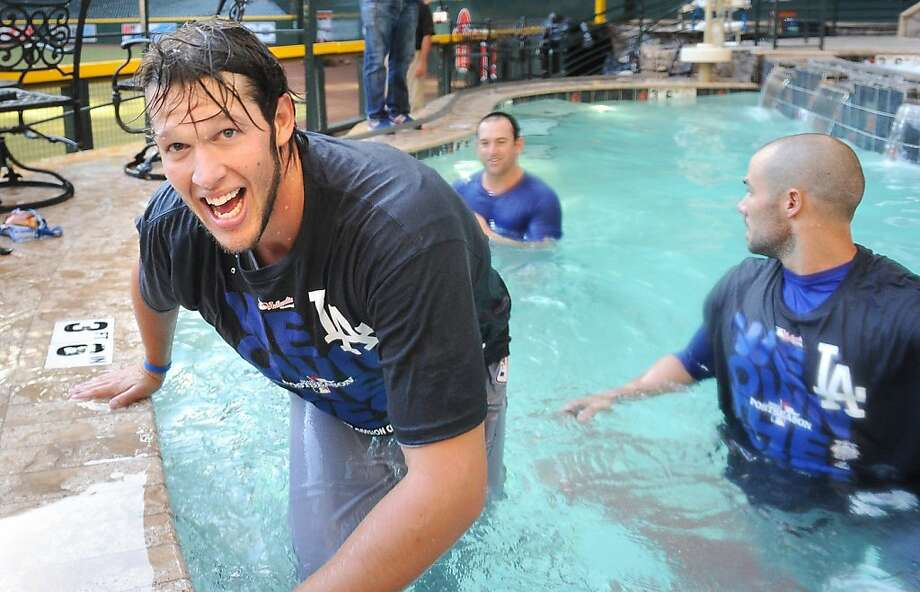 Clayton Kershaw (left), Nick Punto (center background) and others took a victory dip after clinching at Arizona's Chase Field. Photo: Wally Skalij, McClatchy-Tribune News Service