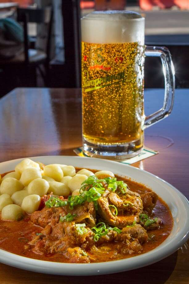 The Chicken Paprikash with a Staropramen lager at Paprika in San Francisco. Photo: John Storey, Special To The Chronicle