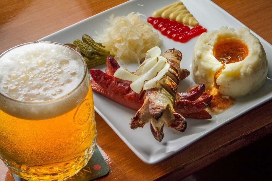 The German Spice sausage and a Bockwurst with a Pilsner Urquell at Paprika in San Francisco. Photo: John Storey, Special To The Chronicle