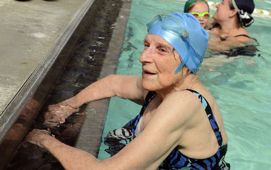 Margaret Wachs celebrates her 100th birthday with a 1/4 mile swim as a fundraiser for the Stratford United Methodist Church Friday, Sept. 20, 2013 at the Woodruff Family YMCA in Milford, Conn. Photo: Autumn Driscoll / Connecticut Post