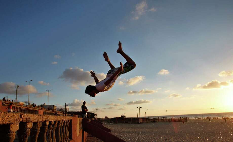 Flipping out:A Palestinian youth practices his Parkour skills during the sunset at Gaza coast of the Mediterranean Sea in Gaza City. Photo: Associated Press