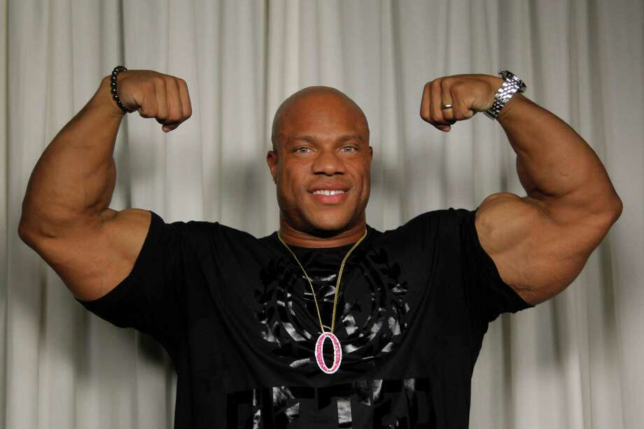 Welcome to the gun show:2012 Mr. Olympia, Phil Heath, poses for a portrait in Los Angeles. Photo: Associated Press