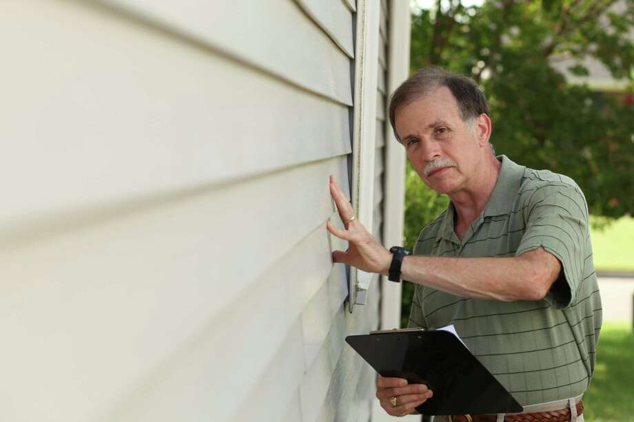 The American Society of Home Inspectors estimates that 77 percent of the homes sold in the United States and Canada today are inspected prior to purchase. / iStockphoto