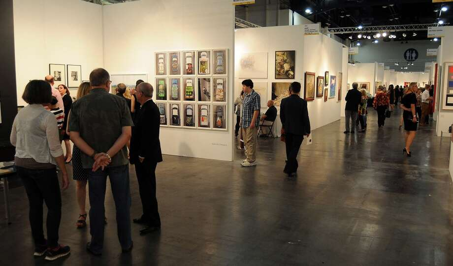Guests browse the booths at the opening night of the Houston Fine Arts Fair at the George R. Brown Convention Center Thursday Sept.19 2013.(Dave Rossman photo) Photo: For The Houston Chronicle