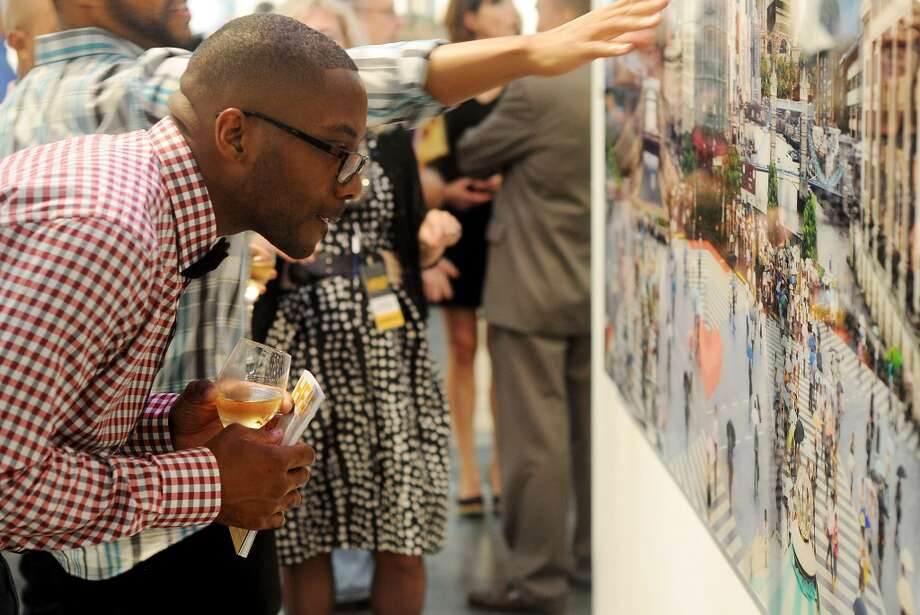 Dontay Staples takes a closer look at one of the pieces at the opening night of the Houston Fine Arts Fair at the George R. Brown Convention Center Thursday Sept.19 2013.(Dave Rossman photo) Photo: For The Houston Chronicle