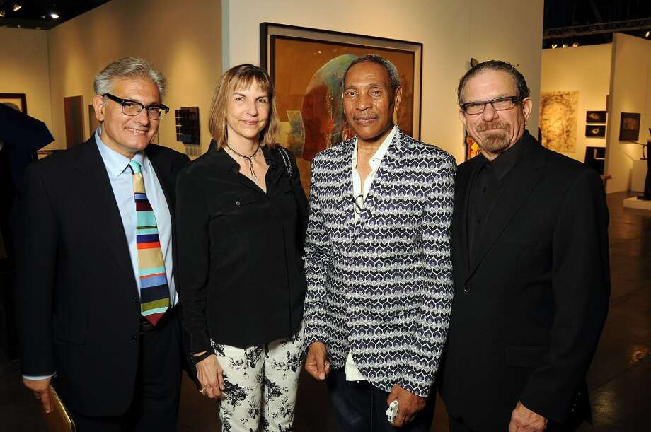 From left: Rick Friedman, Victoria Lightman, John Guess Jr. and Marshal Lightman at the Houston Fine Arts Fair at the George R. Brown Convention Center Thursday Sept.19 2013.(Dave Rossman photo) Photo: For The Houston Chronicle