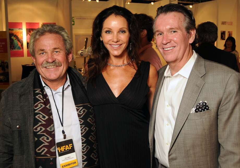 From left: Gino Miles, Renea Menzies and Peter Remmington at the Houston Fine Arts Fair at the George R. Brown Convention Center Thursday Sept.19 2013.(Dave Rossman photo) Photo: For The Houston Chronicle