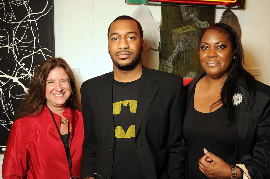 From left: Deborah Colton with Will and Leana Jefferson at the Houston Fine Arts Fair at the George R. Brown Convention Center Thursday Sept.19 2013.(Dave Rossman photo) Photo: For The Houston Chronicle