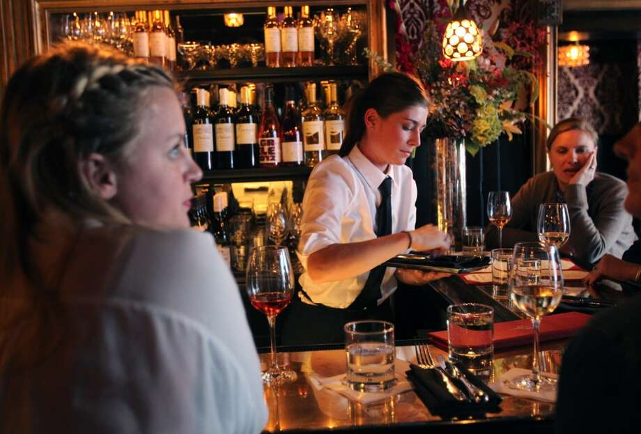 The bar at Cafe Claude. Photo: Leah Millis, The Chronicle