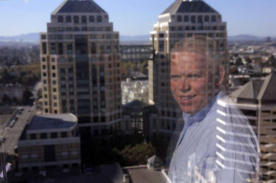 Ed Huber, general manager of Brita, is seen here reflected in his office window that overlooks Oakland's skyline. Photo: Carlos Avila Gonzalez, The Chronicle
