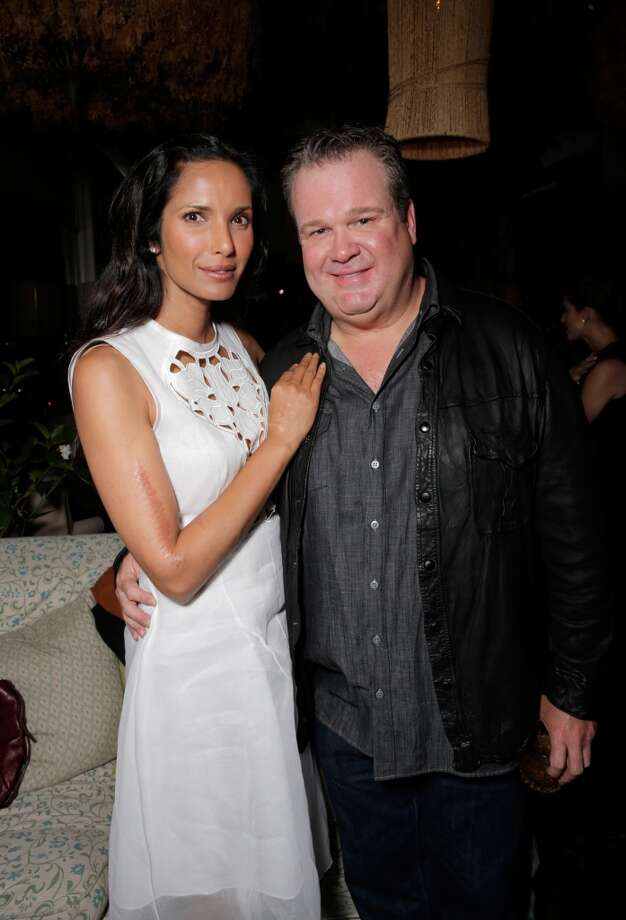From left, Padma Lakshmi and Eric Stonestreet attend The Hollywood Reporter celebration of the Emmy nominees and new fall TV season presented by Samsung Galaxy, Asos, Porsche, Pandora and Ketel One, on Thursday, Sept. 19, 2013, at Soho House in West Hollywood, Calif. (Photo by Todd Williamson/Invision for THR/AP Images) Photo: Todd Williamson, Associated Press