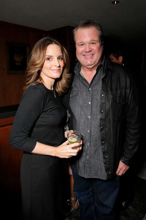 Tina Fey, left, and Eric Stonestreet attend The Hollywood Reporter celebration of the Emmy nominees and new fall TV season presented by Samsung Galaxy, Asos, Porsche, Pandora and Ketel One, on Thursday, Sept. 19, 2013, at Soho House in West Hollywood, Calif. (Photo by Todd Williamson/Invision for THR/AP Images) Photo: Todd Williamson, Associated Press