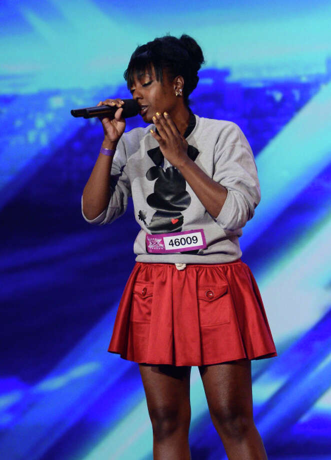 THE X FACTOR: Contestant Ashly Williams pefrorms in front of the Judges on THE X FACTOR airing Thursday, Sep. 19 (8:00-10:00 PM ET/PT) on FOX. CR: Richard Ellis / FOX. © Copyright 2013 / FOX.