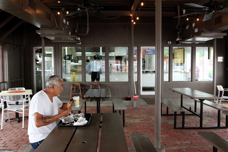 """Armando De Leon, 69, eats in the dinning are of the company's first Taco Cabana at the corner of San Pedro and Hildebrand, Tuesday, Sept. 17, 2013. The company is celebrating its 35th anniversary and will host a grand re-opening of the location on Sept. 21. De Leon said, """"I been coming here a long time, long time."""" Photo: JERRY LARA, San Antonio Express-News / © 2013 San Antonio Express-News"""