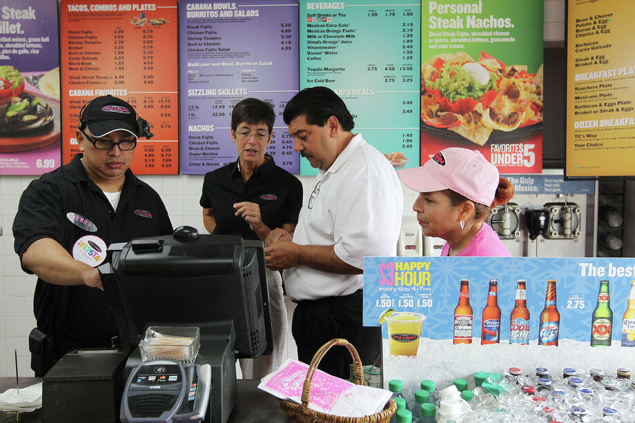 Employees from left, Jerry Torres, Karen Steinbach, Victor Garcia and Mary Lou Montelongo work at the cash register of the company's first Taco Cabana at the corner of San Pedro and Hildebrand, Tuesday, Sept. 17, 2013. The company is celebrating its 35th anniversary and will host a grand re-opening of the location on Sept. 21. Photo: JERRY LARA, San Antonio Express-News / © 2013 San Antonio Express-News