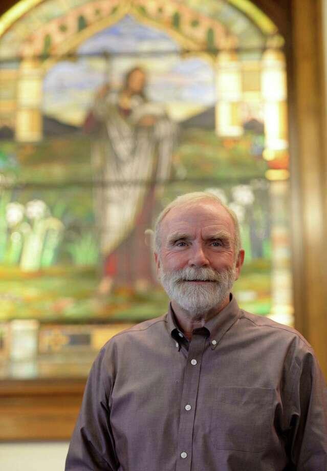 Pastor Dave Corlett of the Delmar Reformed Church Sept 18, 2013 in Delmar, N.Y. (Skip Dickstein/Times Union) Photo: SKIP DICKSTEIN / 00023910A