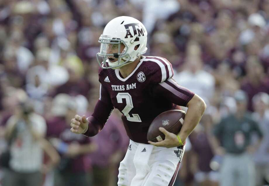 Texas A&M's Johnny Manziel runs against Alabama during the match-up Sept. 14. A reader criticizes those who still find fault with Manziel, arguing that he showed true sportsmanship after the loss. Photo: Eric Gay / Associated Press