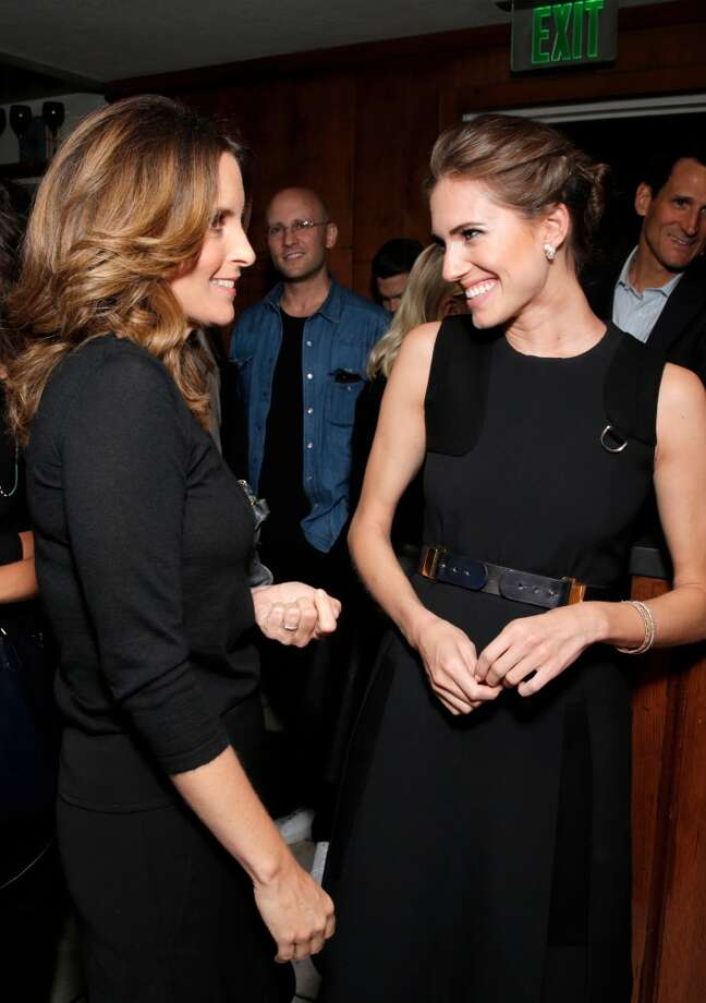 Tina Fey, left, and Allison Williams speak at The Hollywood Reporter celebration of the Emmy nominees and new fall TV season presented by Samsung Galaxy, Asos, Porsche, Pandora and Ketel One, on Thursday, Sept. 19, 2013, at Soho House in West Hollywood, Calif. (Photo by Todd Williamson/Invision for THR/AP Images) Photo: Todd Williamson, Associated Press
