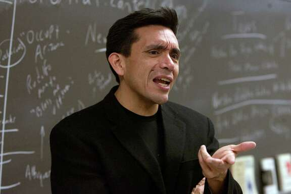 """Tony Diaz teaches a Mexican American Literature class at Houston Community College Monday, Feb. 6, 2012, in Houston. When Diaz heard that Tucson schools were forced to dismantle a popular Mexican American studies program and yank Hispanic history books from classrooms, he started organizing a protest. He invented a word to describe his new mission: Librotraficante - or book trafficker. """"They want to erase our literature, history and our culture.  (Cody Duty / Houston Chronicle)"""
