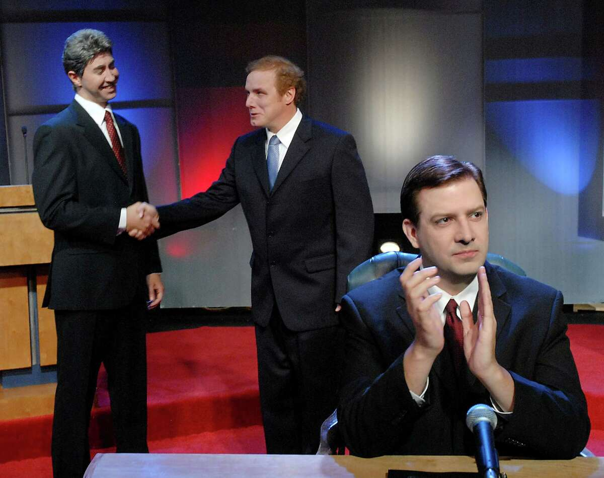From left: Troy Schulze as John Kerry, Paul Locklear as George Bush and Seé¥n Patrick Judge as Jim Lehrer during rehearsals for the Catastrophic Theatre's production of The Strangerer at Diverse Works Monday Oct. 13,2008. (Dave Rossman/For the Chronicle)