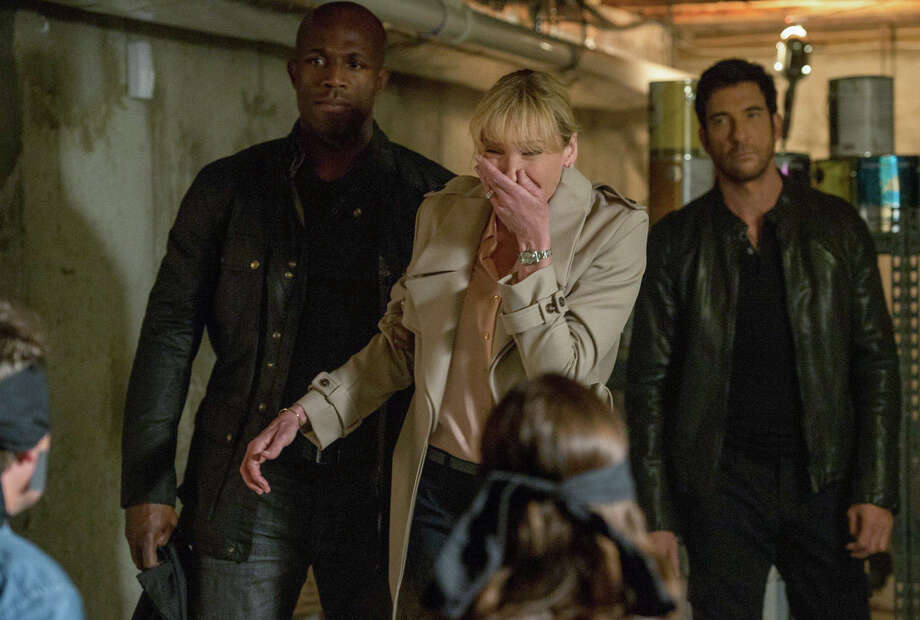 "Rogue FBI agent Duncan Carlisle (Dylan McDermott, right) and armed intruders demand that Dr. Ellen Sanders (Toni Collette) assassinate the president  in ""Hostages."" Photo: David Giesbrecht, Handout / ONLINE_YES"