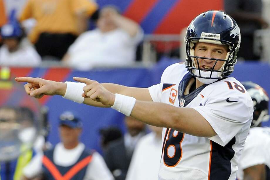 Denver Broncos quarterback Peyton Manning gestures during the first half of an NFL football game against the New York Giants Sunday, Sept. 15, 2013, in East Rutherford, N.J. (AP Photo/Bill Kostroun) Photo: Bill Kostroun, Associated Press
