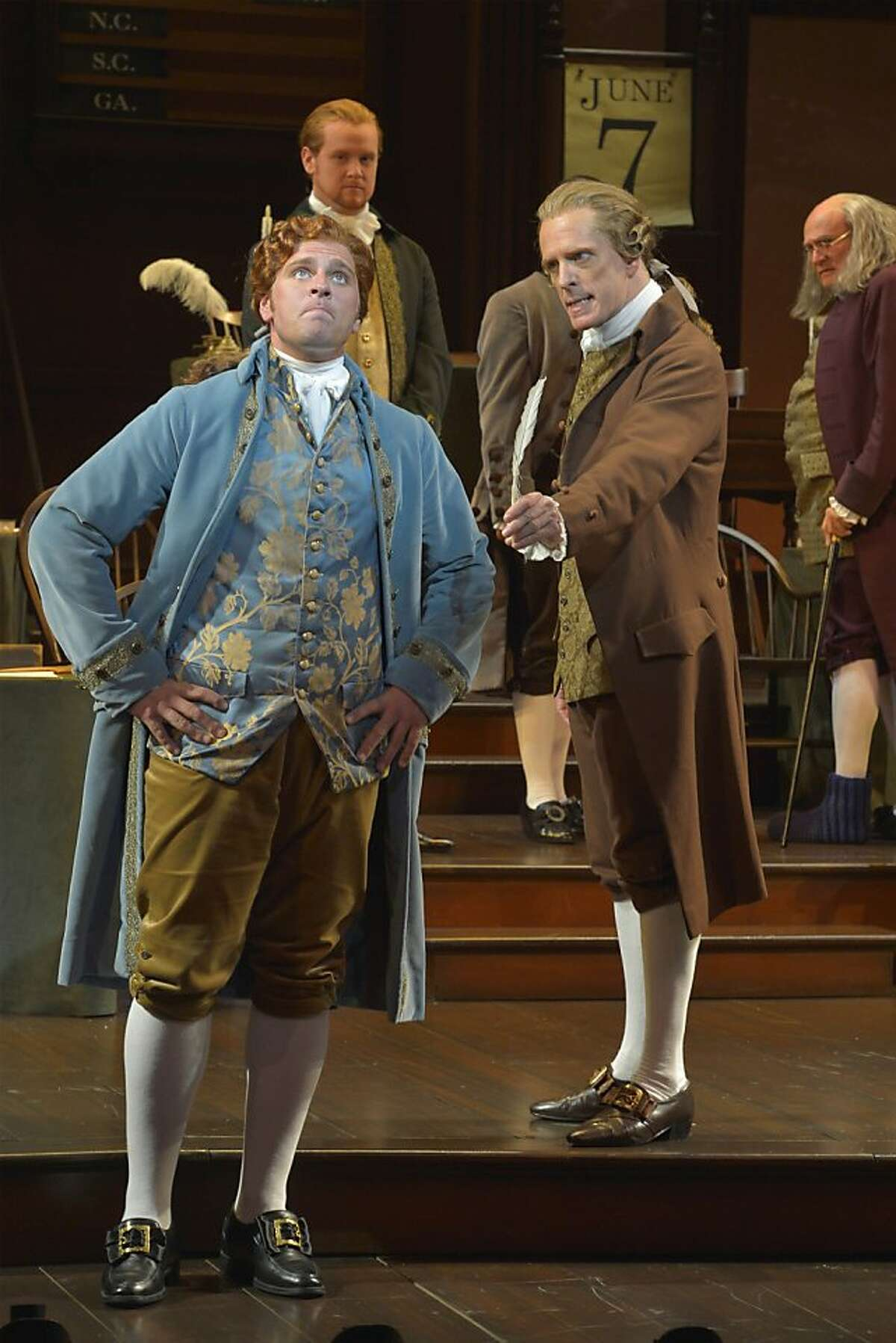 Thomas Jefferson (Brandon Dahlquist left) resists as John Adams (John Hickok) insists he's the best person to write the Declaration of Independence in the musical
