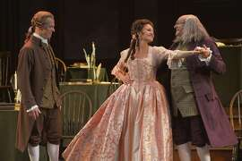 "John Adams (John Hickok, left) and Benjamin Franklin (Andrew Boyer, right) welcome Martha Jefferson (Andrea Prestinario) to Philadelphia in the musical ""1776"" at ACT."