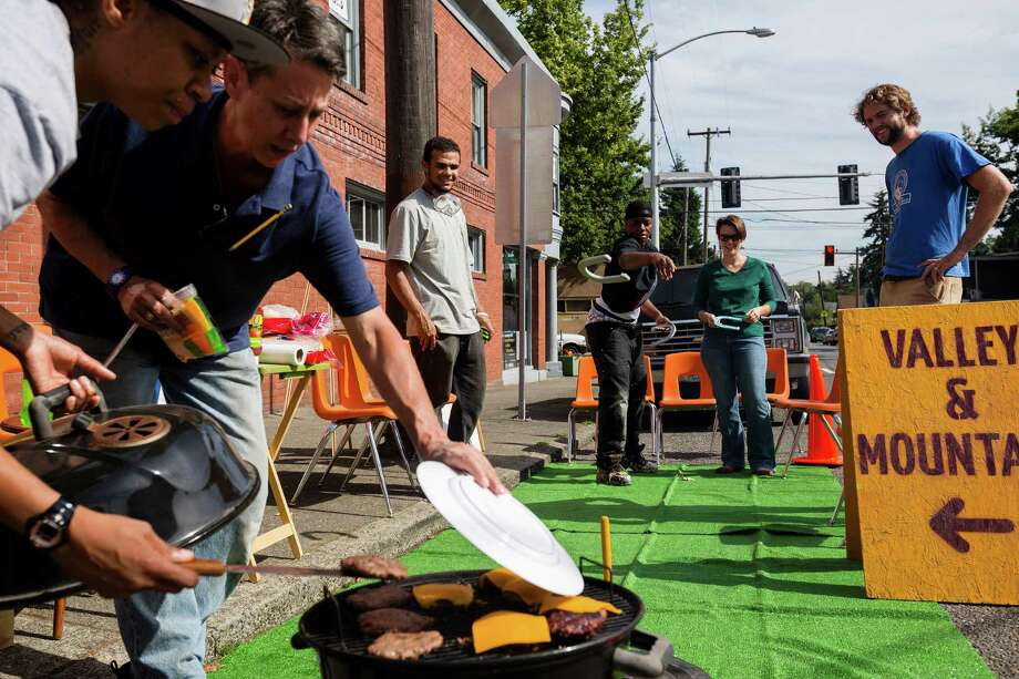 Supporters and volunteers play a round of horseshoes and barbecue burgers at the Valley & Mountain space as part of the annual PARK(ing) Day on Rainier Avenue South and South Orcas Street. Photo: JORDAN STEAD, SEATTLEPI.COM / SEATTLEPI.COM