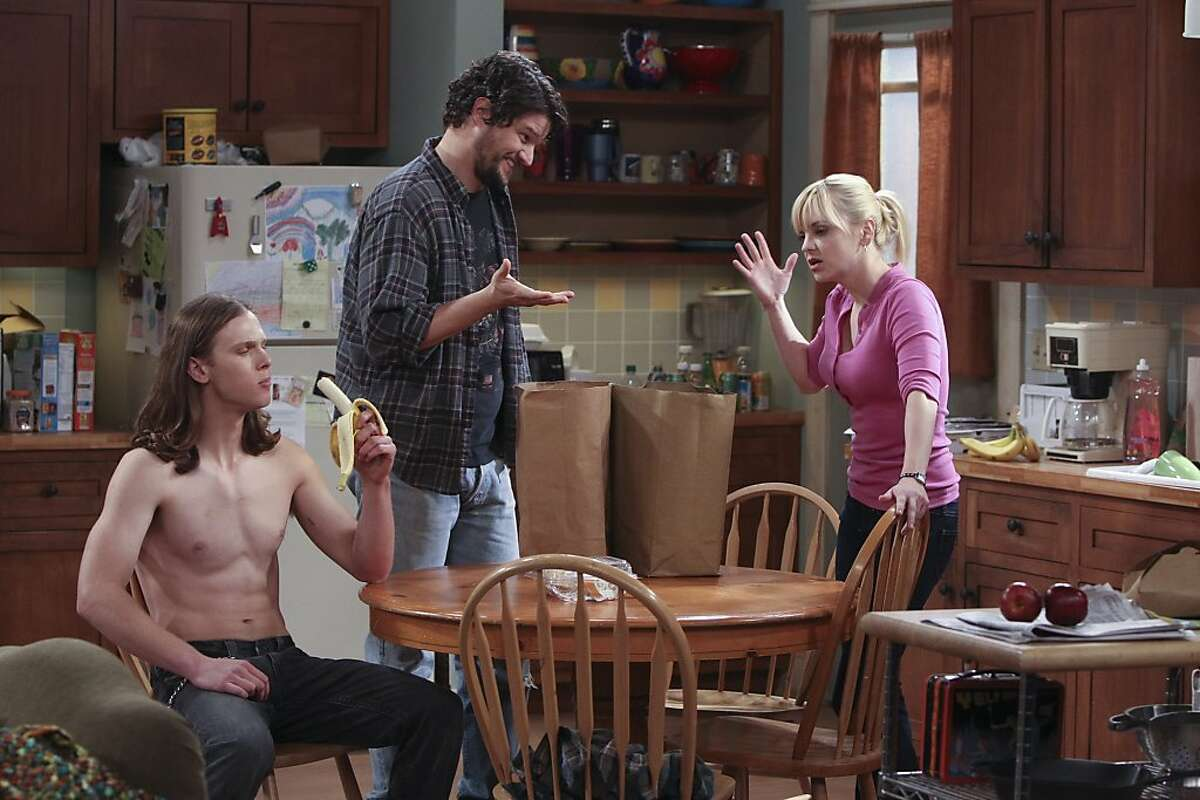 This publicity image released by CBS shows, from left, Spencer Daniels, Matt Jones, and Anna Faris in a scene from