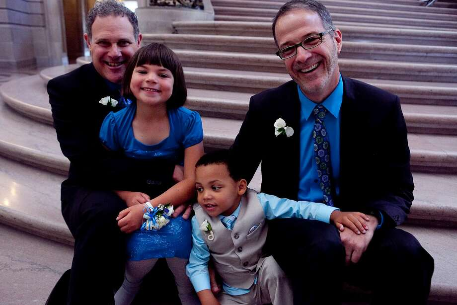 David Kerr and Jay Stowsky married at City Hall Aug. 14, with their adopted children, Shayla, 6, and Jaden, 3, in attendance. Photo: Nicolas Smith