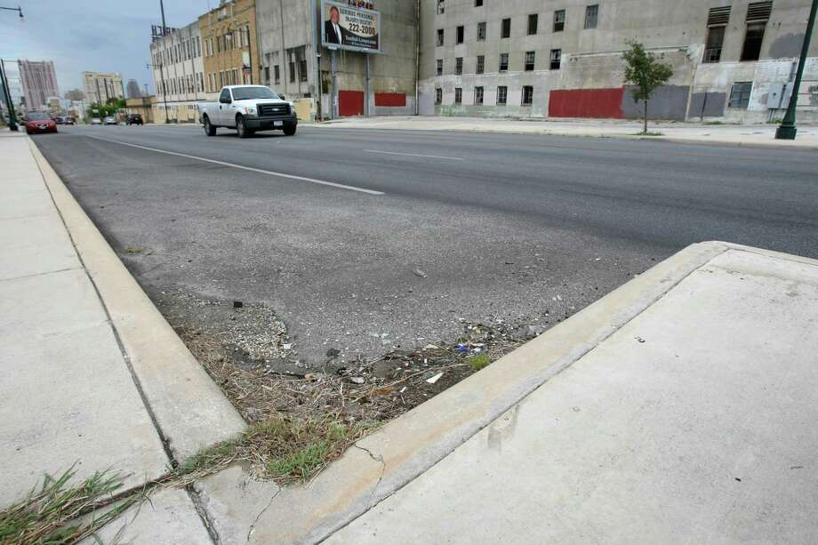 """As part of a larger construction project on the 1200-1700 stretch of East Commerce the city changed the formation of the curbs. At either end of every block, the curb juts into the street -- one local business owner dubs them the """"cement horns."""" They are intended to mark the parking lane but business owners say cars crash into them regularly. Photo: Helen L. Montoya, San Antonio Express-News / ©2013 San Antonio Express-News"""