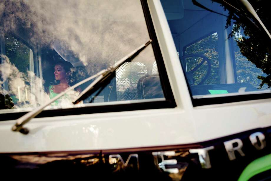 A young woman relaxes in the shade of the cabin of a Metro van on the third and final day of the annual Bumbershoot arts and music festival. Photo: JORDAN STEAD, SEATTLEPI.COM / SEATTLEPI.COM