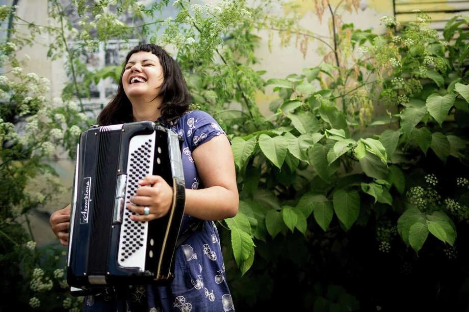 Nichole VonLudke plays her accordion for passers-by at the annual Georgetown Carnival. The quirky event featured live music, burlesque and crafting. Photo: JORDAN STEAD, SEATTLEPI.COM / SEATTLEPI.COM