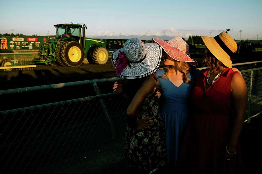 Young women watch a tractor smooth out the dirt at Emerald Downs in Auburn. Photo: JORDAN STEAD, SEATTLEPI.COM / SEATTLEPI.COM