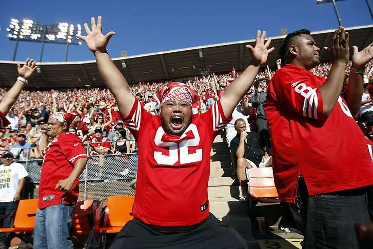 Lu Angeles, center, of Daly City Cheers as the 49er's score during the fourth quarter as the 49er's first regular season game against the Green bay Packers at Candlestick Park in San Francisco, CA Sunday September 8, 2013.