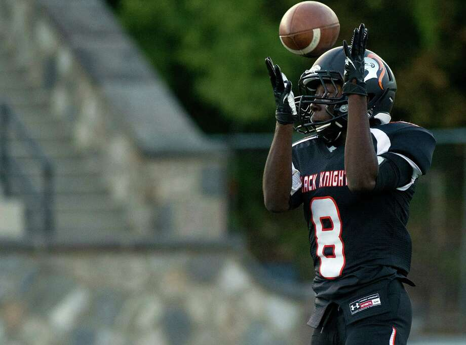 Stamford's Rigerson Gelin makes a catch during Friday's football game against Harding High School at Stamford High School on Sept. 20, 2013. Photo: Lindsay Perry / Stamford Advocate