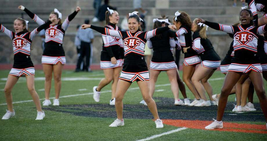 Stamford cheerleaders perform during Friday's football game at Stamford High School on Sept. 20, 2013. Photo: Lindsay Perry / Stamford Advocate