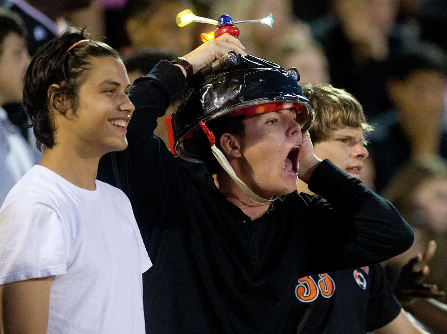 Stamford fans cheer for their team during Friday's football game at Stamford High School on Sept. 20, 2013. Photo: Lindsay Perry / Stamford Advocate