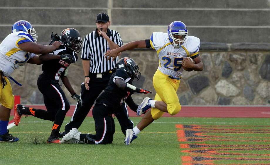 Harding High School's D.J. Smith carries the ball to a touchdown during Friday's football game at Stamford High School on Sept. 20, 2013. Photo: Lindsay Perry / Stamford Advocate