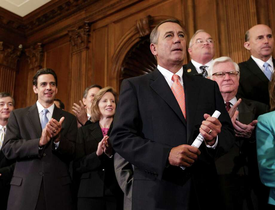 "Speaker John Boehner, R-Ohio, is cheered as Republican House members rally after passing a bill that would prevent a government shutdown while crippling the health care law. Boehner has challenged Sen. Ted Cruz, R-Texas, to ""pick up mantle"" on the fight against the Affordable Health Care law. Photo: J. Scott Applewhite, STF / AP"