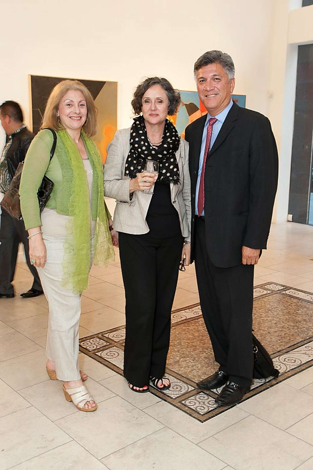 Mexican American figurative artist Miguel Conde, who has lived for decades in Spain, appeared at the opening of his first U.S. show, a retrospective, at the Serge Sorokko Gallery, running from Sept. 19-Oct. 19, 2013. A private tour was held Sept. 17, 2013. From left to right, Mara Perez, Georgianna de la Torre, and Mario Diaz of Wells Fargo Bank.