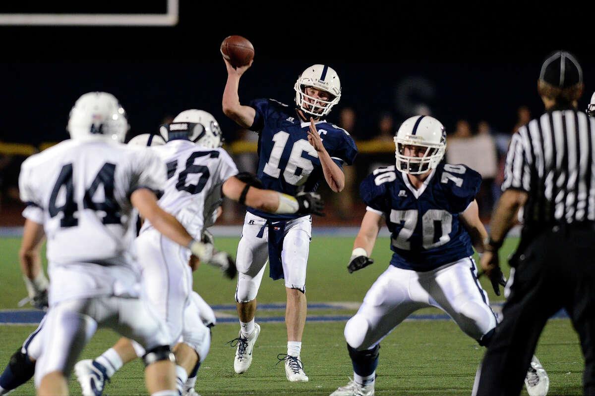 Staples #16 Jack Massie throws a pass as Staples High School hosts Wilton High School in varsity football in Westport, CT on Fri. Sept. 20, 2013.