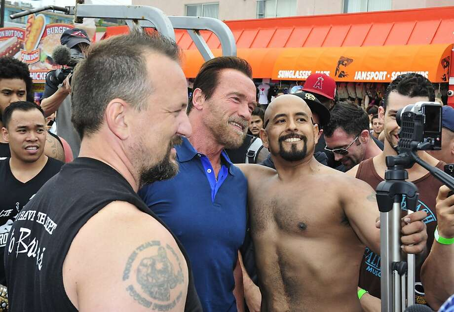 VENICE, CA - SEPTEMBER 20:  Arnold Schwarzenegger (C) hosts a special body building experience at the famed Muscle Beach Venice to celebrate the launch of the Arnold Series, an exclusive line of new nutritional supplements developed by Schwarzenegger and MusclePharm on September 20, 2013 in Venice, California. Photo: Jerod Harris, Getty Images For MusclePharm