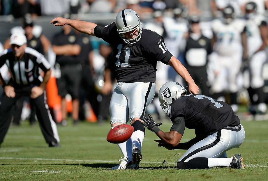 Marquette King (right) is still getting used to holding for Sebastian Janikowski after Shane Lechler did it for 13 years. Photo: Thearon W. Henderson, Getty Images