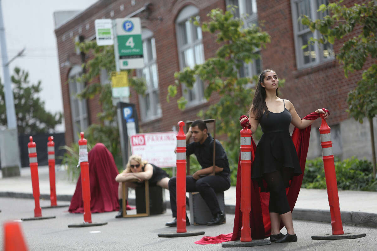 Cornish College of the Arts student Jebecca Janecek, right, poses with other students in one of the school's spaces used for performance art during PARK(ing) Day in Seattle.