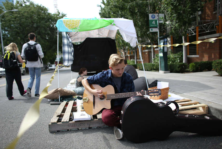 Brodie Mills plays his guitar in one of the Cornish College of the Arts spaces during PARK(ing) Day. Photo: JOSHUA TRUJILLO, SEATTLEPI.COM / SEATTLEPI.COM