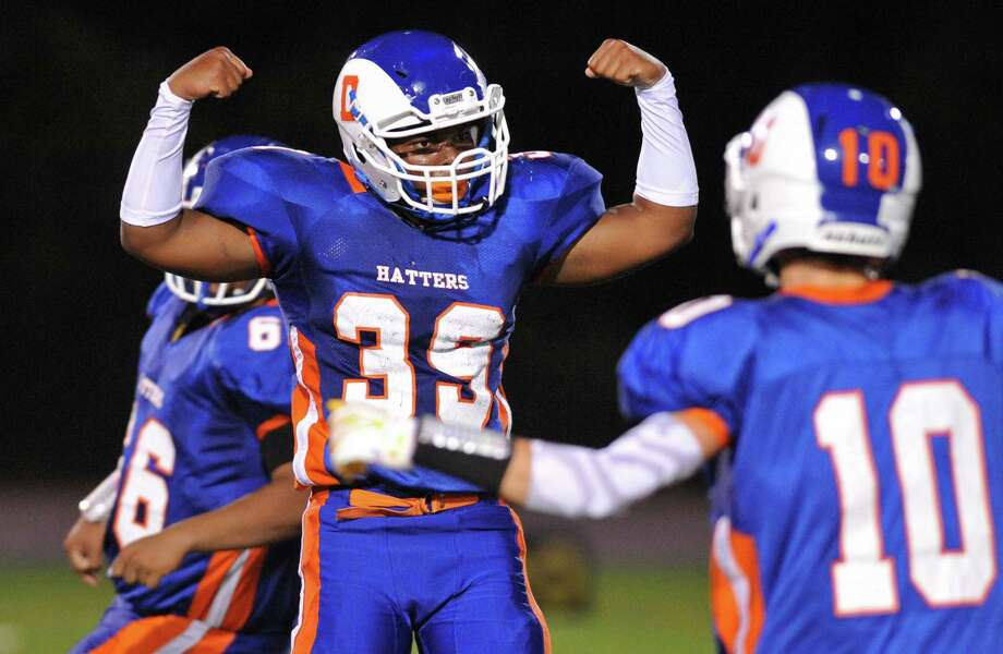 Danbury's Marlon Black (39) celebrates in the FCIAC high school football game between Danbury and Norwalk at Danbury High School in Danbury, Conn. on Friday, Sept. 20, 2013. Photo: Tyler Sizemore / The News-Times