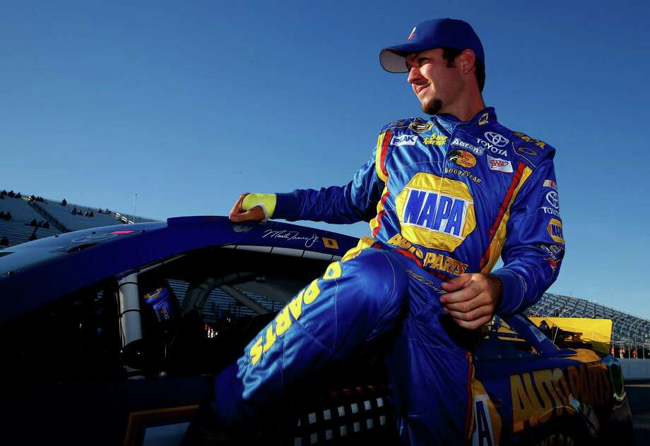 LOUDON, NH - SEPTEMBER 20:  Martin Truex Jr., driver of the #56 NAPA Auto Parts Toyota, climbs from his car after qualifying for the NASCAR Sprint Cup Series Sylvania 300 at New Hampshire Motor Speedway on September 20, 2013 in Loudon, New Hampshire.  (Photo by Jared Wickerham/Getty Images) ORG XMIT: 181319738 Photo: Jared Wickerham / 2013 Getty Images