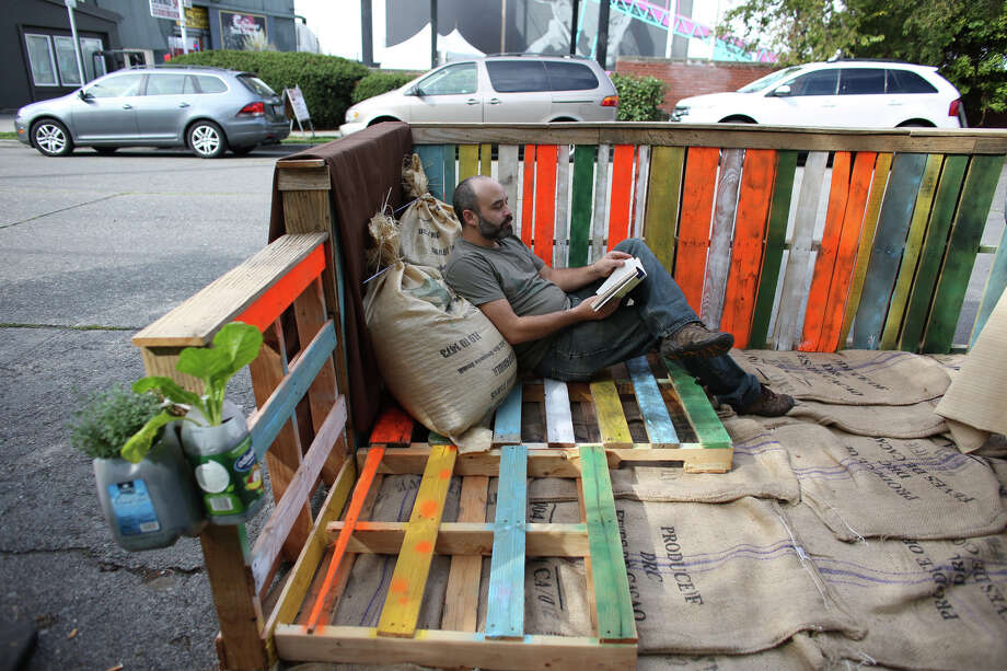 Steve Leroux relaxes in the Theo Chocolate space on Phinney Avenue North in Fremont during PARK(ing) Day. Photo: JOSHUA TRUJILLO, SEATTLEPI.COM / SEATTLEPI.COM